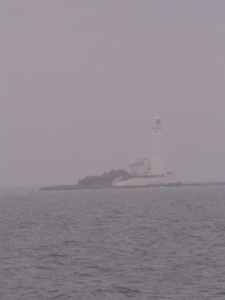 The lighthouse and the sea fret...